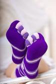 Female legs in purple socks — Stock Photo