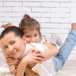 Stock Photo: Portrait of daughter riding on her mother hugging