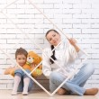 Mother and 5 year old daughter , holding a toy — Stockfoto