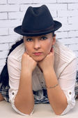 Large portrait woman in a hat — Stock Photo
