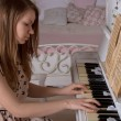 Young woman playing the piano - Stock Photo