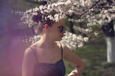 Woman with flowering tree — Foto Stock