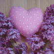 Royalty-Free Stock Photo: Textile heart polka dot next to a lilac