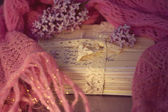Old letters with lilac on soft scarf — Stok fotoğraf