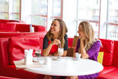 Two girl-friends talk in cafe — Stock Photo