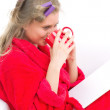 Girl in red robe — Stock Photo