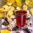 Red Tea and autumn leafs — Stock Photo