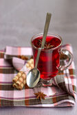 Red Tea and wafer rolls — Stock Photo