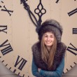 Girl on a background of huge clock — Foto de Stock
