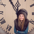 Girl on a background of huge clock — Stockfoto