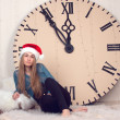 Girl on clocks background lunch time — Stock Photo