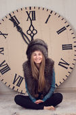 Girl on a background of huge clock — Stock Photo