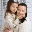 Mom and daughter in the winter dresses — Stock Photo