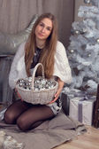 Girl surrounded by Christmas paraphernalia — Stok fotoğraf
