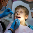 Stock Photo: Boy in a dental surgery