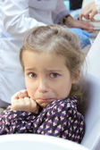 Frightened girl at dentist's office — Stock Photo