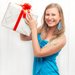 Woman in dress with present — Stock Photo
