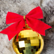 Christmas ball on white fur — Stock Photo