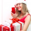 Young smiling woman hold christmas gift box — Stock Photo