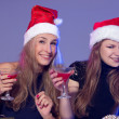 Girlfriends in Christmas hats with cocktails — Stock Photo