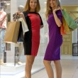 Beautiful girls with shopping bags — Stock Photo