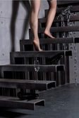Woman skirt going up the stairs at home — Stockfoto