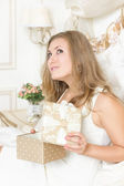 Girl gifts relaxing on bed at home luxury interior — Stock Photo