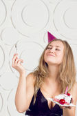 Girl blowing candles — Stock Photo