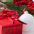 Christmas gift with branch firtree — Stock Photo #35136219
