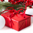 Christmas gift with branch firtree — Stock Photo #35136837