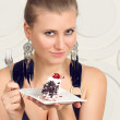 Young woman eating chocolate cake — Stock Photo