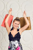 Happy woman holding shopping bags — 图库照片
