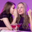 Female friends enjoying cocktails  in a nightclub — Stock Photo