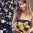 Stock Photo: Woman with gift box and christmas tree
