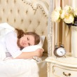 Sleepless woman lying in bed — Stock Photo