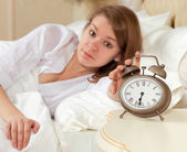 Woman's hand off the alarm clock — Stock Photo