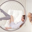 Girl sitting in a chair suspended round — Foto de Stock
