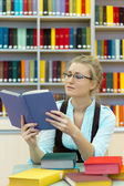Portrait of clever student with open book reading — Foto Stock