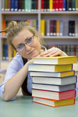 Portrait of clever student with open book reading — Stock Photo