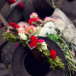 Stock Photo: Kiev, Ukraine, Evromaydan: flowers on tires