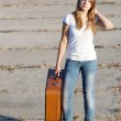 Beautiful girl with a suitcase — Stock Photo #7580639