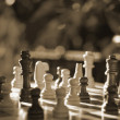 Chess pieces on wood board — Stock fotografie #12442361