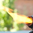 Old blowtorch with fire - Stock Photo