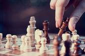 Woman playing chess — Stock Photo