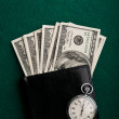 Money in wallet and stopwatch — Stock Photo