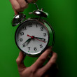 Womholding alarm clock — Stock Photo #18558815