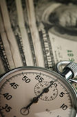 Dollars bills and stopwatch — Stock Photo