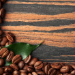 Green leaf and coffee — Stock Photo