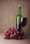 Wine glass with grape — Stock Photo