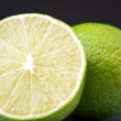 Green limes background — Stock Photo